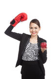 Young Asian business woman with red apple and boxing glove Stock Photography
