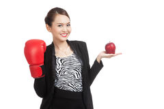 Young Asian business woman with red apple and boxing glove Royalty Free Stock Images