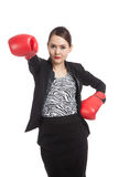 Young Asian business woman with red boxing gloves Royalty Free Stock Image