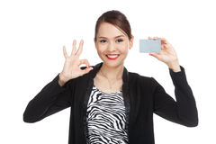 Young Asian business woman show OK with a blank card Stock Photography