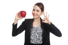 Young Asian business woman show OK with red apple Royalty Free Stock Images