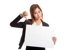 Young Asian business woman show thumbs down with  white blank si Stock Photos