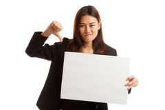 Young Asian business woman show thumbs down with  white blank si Stock Photography