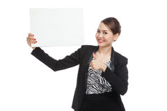 Young Asian business woman show thumbs up with  white blank sign Royalty Free Stock Photos