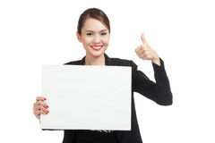 Young Asian business woman show thumbs up with  white blank sign Stock Photos