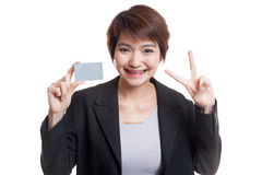 Young Asian business woman show Victory with a blank card. Royalty Free Stock Image