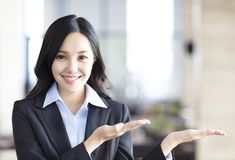 Young asian business woman showing stock images