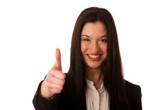 Young asian business woman showing thumb up gesturing success -. Ok sign isolated over white Royalty Free Stock Photography