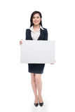 Young asian business woman showing a white board isolated on whi Royalty Free Stock Images