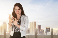 Young asian business woman with a smartphone Stock Photography