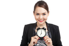 Young Asian business woman smile with a clock Stock Images