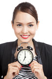 Young Asian business woman smile with a clock Stock Photo