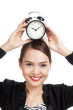 Young Asian business woman smile with a clock Stock Photography