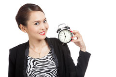 Young Asian business woman smile with a clock Royalty Free Stock Image