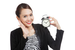 Young Asian business woman smile with a clock Royalty Free Stock Photography
