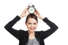 Young Asian business woman smile with a clock Royalty Free Stock Images