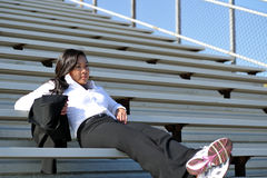 Young Asian business woman in stadium Stock Image