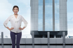 Young asian business woman standing on the office balcony Royalty Free Stock Photo