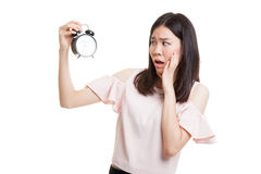 Young Asian business woman is  stressed with a clock. Stock Images