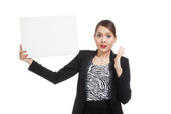 Young Asian business woman  surprise with  white blank sign Stock Image