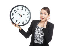 Young Asian business woman surprised with a clock Royalty Free Stock Images