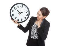 Young Asian business woman surprised with a clock Stock Photo