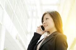 Young Asian business woman talking on mobile phone Royalty Free Stock Image
