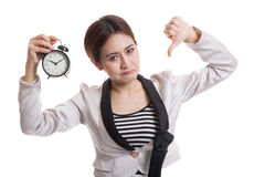 Young Asian business woman thumbs down with a clock. Young Asian business woman thumbs down with a clock  isolated on white background Stock Images