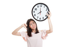 Young Asian business woman thumbs down with a clock. Stock Image