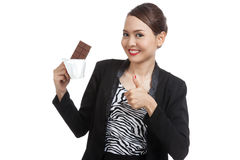 Young Asian business woman  thumbs up with chocolate bar Stock Photography