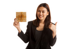 Young Asian business woman thumbs up with a gift box. Stock Photos