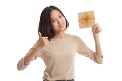 Young Asian business woman thumbs up with a gift box Stock Image
