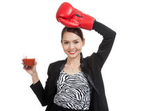 Young Asian business woman with tomato juice and boxing glove Royalty Free Stock Images