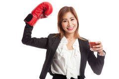 Young Asian business woman with tomato juice and boxing glove Stock Image