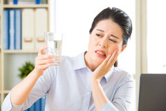 Young asian business woman with tooth sensitivity. In office Stock Photo