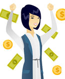 Young asian business woman under money rain. Royalty Free Stock Photos