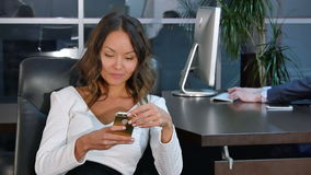 Young asian business woman using mobile phone in office. Young asian businesswoman using mobile phone in office. Professional shot in 4K resolution. 085. You can stock video