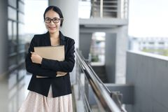 Asian business woman wear suit holding file document stock images