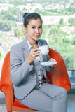 Young asian business woman about of the window Royalty Free Stock Photography