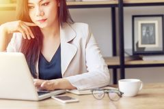 young Asian business woman at work. beautiful Asian woman in casual suit working with computer laptop in modern office. freelance royalty free stock photography