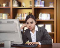 Young asian business woman working with computer Stock Photo