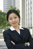 Young asian business women. A young asian business women look at camera Royalty Free Stock Image