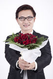 Young Asian Businessman with bouquet. Asian Businessman offering a bouquet of rose Stock Photos