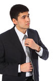 Young Asian Businessman Corrects Tie Royalty Free Stock Photo