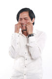 Young Asian Businessman Crying Royalty Free Stock Image