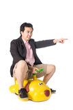 Young Asian businessman driving a baby toy car look like dog, is Stock Photography