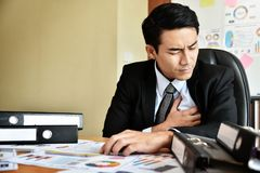Businessman having heart attack. Royalty Free Stock Photo