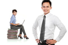 Young asian businessman, with his secretary behind. isolated in Stock Images