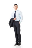 Young Asian businessman hold coat Royalty Free Stock Image