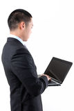 Young asian businessman holding laptop Royalty Free Stock Images